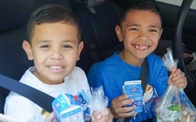 Kids receiving meal